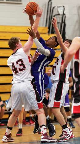 #10 Westhill high school Yveson Cassamajor tries to get a shot off in a boys basketball game against Fairfield Warde high school played at Fairfield Ludlowe high school, Fairfield CT on Tuesday January 22nd, 2013. Photo: Mark Conrad / Connecticut Post Freelance
