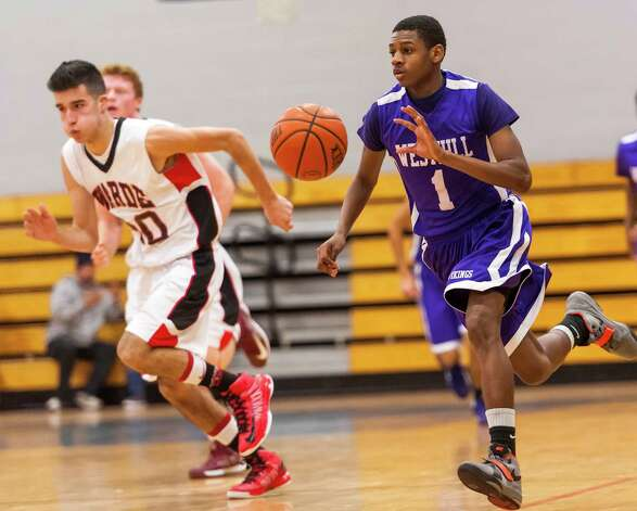 #1 Westhill high school Jeremiah Livingston moves the ball up court in a boys basketball game against Fairfield Warde high school played at Fairfield Ludlowe high school, Fairfield CT on Tuesday January 22nd, 2013. Photo: Mark Conrad / Connecticut Post Freelance