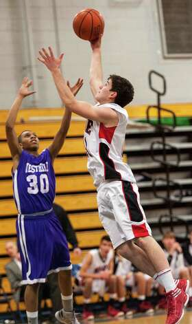 #31 Fairfield Warde high school TJ Gallagher goes up for a shot in a boys basketball game against Westhill high school played at Fairfield Ludlowe high school, Fairfield CT on Tuesday January 22nd, 2013. Photo: Mark Conrad / Connecticut Post Freelance