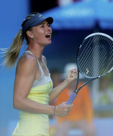 Russia's Maria Sharapova celebrates her quarterfinal win over compatriot Ekaterina Makarova at the Australian Open tennis championship in Melbourne, Australia, Tuesday, Jan. 22, 2013.(AP Photo/Dita Alangkara) Photo: Dita Alangkara