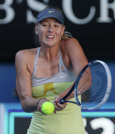 Russia's Maria Sharapova hits a return to compatriot Ekaterina Makarova at the Australian Open tennis championship in Melbourne, Australia, Tuesday, Jan. 22, 2013.(AP Photo/Dita Alangkara) Photo: Dita Alangkara