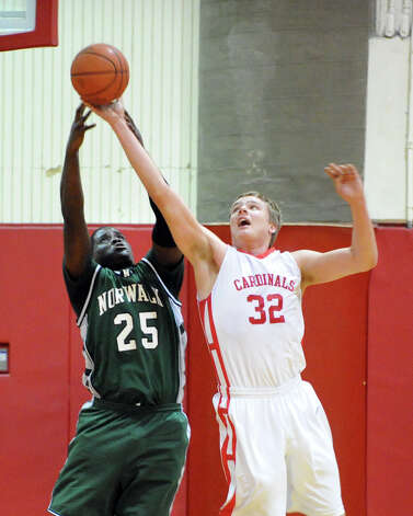 At left, Saeed Soulemane # 25 of Norwalk goes for a rebound against Alex Wolf # 32 of Greenwich during the boys high school basketball game between Greenwich High School and Norwalk High School at Greenwich, Tuesday night, Jan. 22, 2013. Photo: Bob Luckey / Greenwich Time