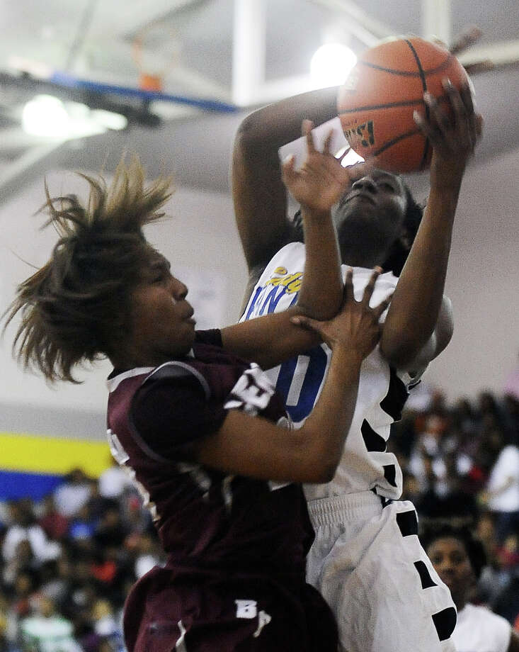 Ozen Lady Panther SanQueisha Rawls, #10, wins the rebound during the Ozen High School girls basketball game against Central High School on Tuesday, January 22, 2013, at Ozen High School.  Ozen won 63 - 53. Photo taken: Randy Edwards/The Enterprise