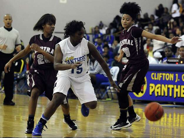 Central Lady Jaguar Talitha Savoy, #20, swats the ball out of Ozen Lady Jaguars hands during the Ozen High School girls basketball game against Central High School on Tuesday, January 22, 2013, at Ozen High School.  Ozen won 63 - 53. Photo taken: Randy Edwards/The Enterprise Photo: Randy Edwards