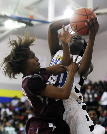 Ozen Lady Panther SanQueisha Rawls, #10, wins the rebound during the Ozen High School girls basketball game against Central High School on Tuesday, January 22, 2013, at Ozen High School.  Ozen won 63 - 53. Photo taken: Randy Edwards/The Enterprise Photo: Randy Edwards
