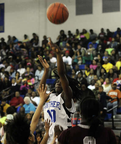 Ozen Lady Panther SanQueisha Rawls, #10, puts it up for two during the Ozen High School girls basketball game against Central High School on Tuesday, January 22, 2013, at Ozen High School.  Ozen won 63 - 53. Photo taken: Randy Edwards/The Enterprise
