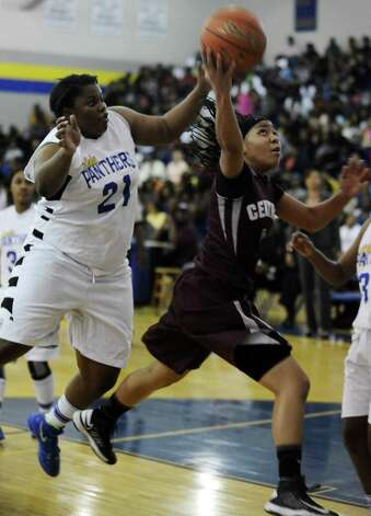 Central Lady Jaguar Malena Washington, #1, puts it up for two during the Ozen High School girls basketball game against Central High School on Tuesday, January 22, 2013, at Ozen High School.  Ozen won 63 - 53. Photo taken: Randy Edwards/The Enterprise Photo: Randy Edwards