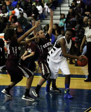 Ozen Lady Panther Bealoved Brown, #14, is covered by two Central Lady Jaguars while looking to pass during the Ozen High School girls basketball game against Central High School on Tuesday, January 22, 2013, at Ozen High School.  Ozen won 63 - 53. Photo taken: Randy Edwards/The Enterprise Photo: Randy Edwards