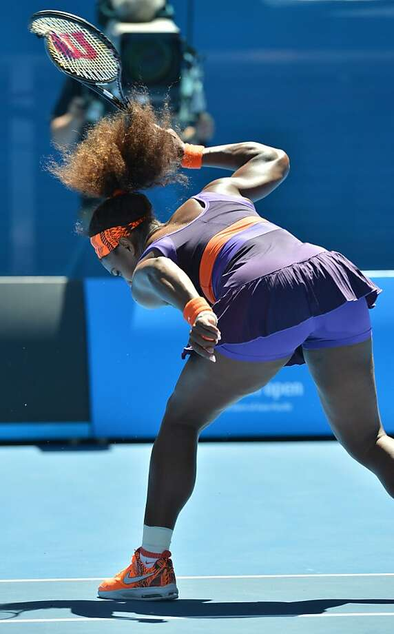 Serena Williams smashes her racket during her match against Sloane Stephens. Photo: Paul Crock, AFP/Getty Images