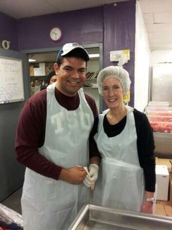 Texas Southern University student regent, Ph.D. student and hunger relief volunteer Juan Sorto met U.S. Health and Human Services Secretary Kathleen Sebelius while preparing breakfast on Saturday, Jan. 19, 2013 at DC Central Kitchen. (Juan Sorto | Courtesy)