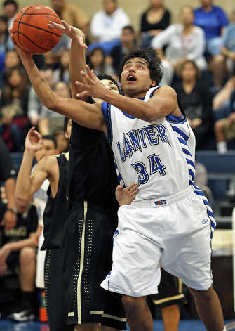 Lanier's Ajax Reyes gets to the bucket in the first half as Lanier hosts Edison in boys basketball at Lanier on January 22, 2013. Photo: Tom Reel, San Antonio Express-News / ©2012 San Antono Express-News