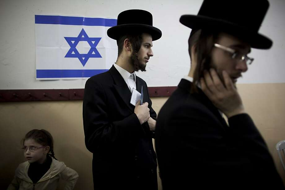 An Ultra-orthodox Jewish man holds his ID card as he waitS to vote in Bnei Brak, Israel, during legislative elections, Tuesday, Jan. 22, 2013.  Israelis began trickling into polling stations Tuesday morning to cast their votes in a parliamentary election expected to return Prime Minister Benjamin Netanyahu to office despite years of stalled peacemaking with the Palestinians and mounting economic troubles. Polls indicate about a dozen of 32 parties competing in Tuesday's election have a chance of winning seats in the 120-member parliament. Most parties fall either into the right-wing-religious or center-left camp, and surveys indicate hard-line and ultra-Orthodox Jewish parties will command a majority. Photo: Oded Balilty, Associated Press