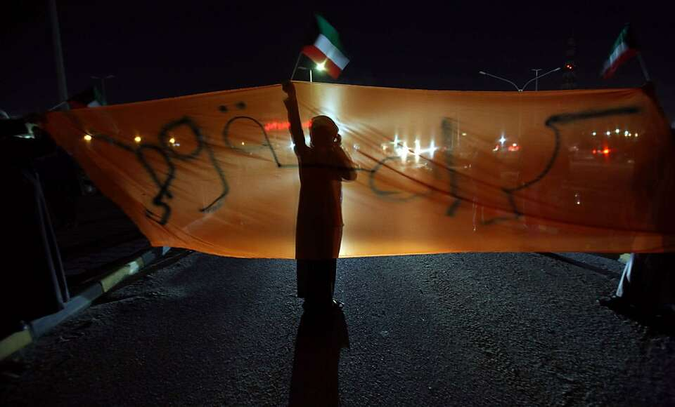 Kuwait opposition supporters take part in a demonstration to demand the dissolution of the parliamen