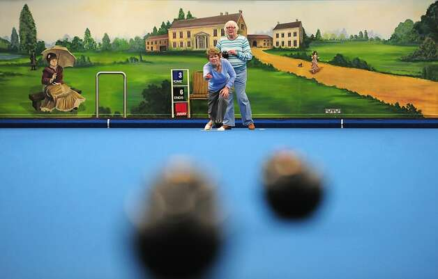When it's cold outside, lawn bowlers roll under a roof, like this couple at the World Indoor Bowls Championships at Potters Holiday Camp in Norwich, England. Photo: Jamie McDonald, Getty Images