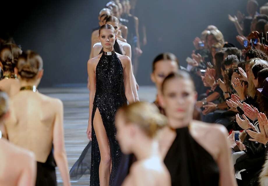 Models wear creations by French fashion designer Alexandre Vauthier as part of the Women's Spring/Summer 2013 Haute Couture fashion collection presented in Paris, Tuesday, Jan. 22 2013. Photo: Jacques Brinon, Associated Press