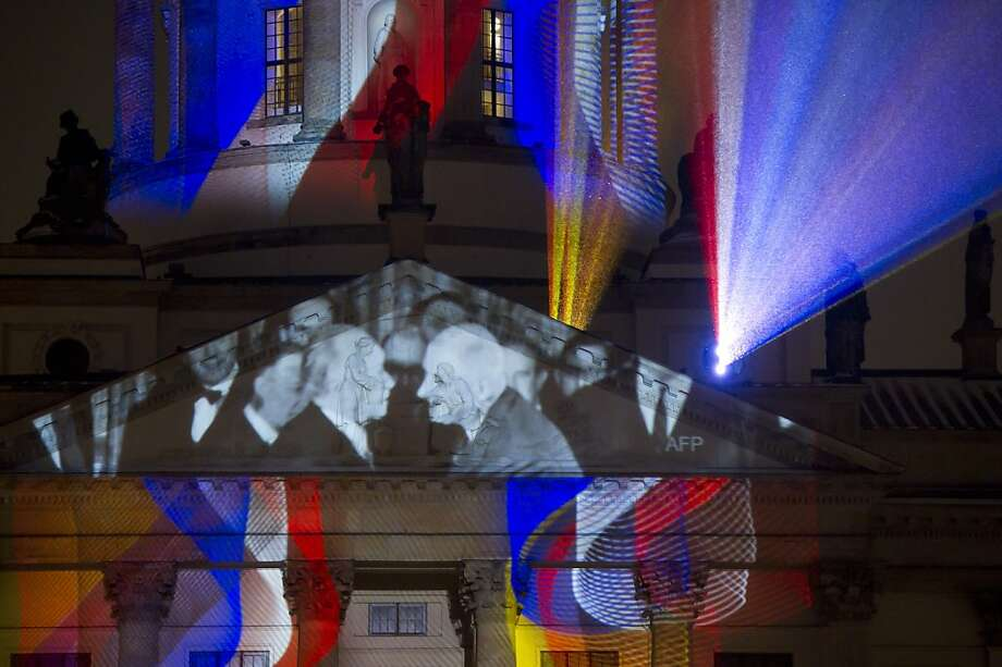 The image of then French president Charles de Gaulle (R) and West German chancellor Konrad Adenauer (L) is projected on the church Berliner Dom on January 21, 2013 in Berlin on the eve of the celebration to mark 50 years since the Elysee Treaty launched after WWII French-German cooperation. In signing the landmark treaty on January 22, 1963, then French president Charles de Gaulle and West German chancellor Konrad Adenauer sealed a new era of reconciliation between the former foes which has since driven European unity. Photo: Marc Tirl, AFP/Getty Images
