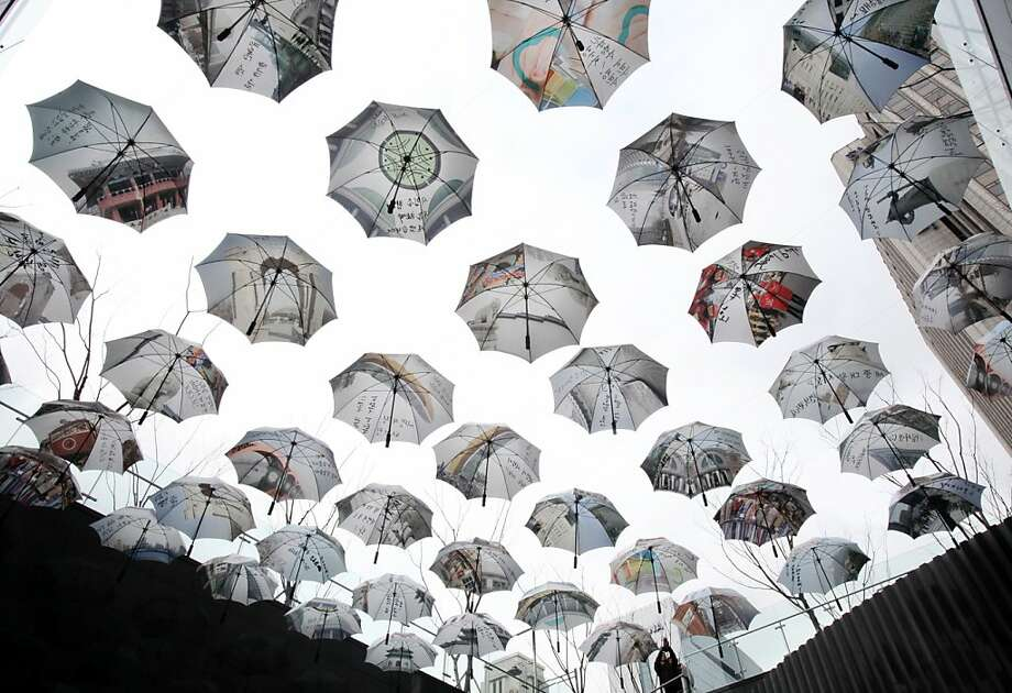 Umbrellas are displayed in front of Seoul City Hall in Seoul, South Korea, Tuesday, Jan. 22, 2013. This display symbolizes Seoul public officials' intention to be an umbrella for Seoul citizens. Photo: Ahn Young-joon, Associated Press