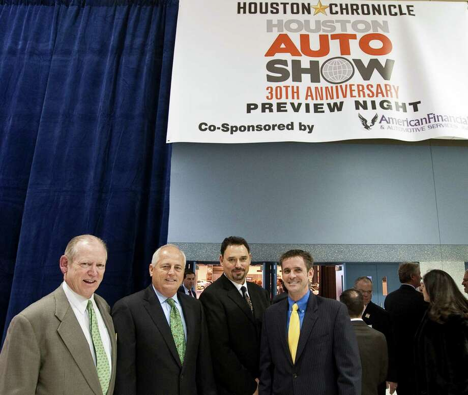 Left to right: Jack Sweeney, Houston Chronicle chairman; Tom Stephenson, Houston Chronicle publisher; Alex Sanchez, Publisher of La Voz andVice President, Marketing & Auto Advertising; and John T. O'Loughlin, president of the Houston Chronicle and Houston Chronicle Media Group, open the Houston Autoshow 30th Preview presented by the Houston Chronicle, Tuesday, Jan. 22, in Reliant Center in Houston. Photo: Nick De La Torre, Houston Chronicle / © 2013  Houston Chronicle