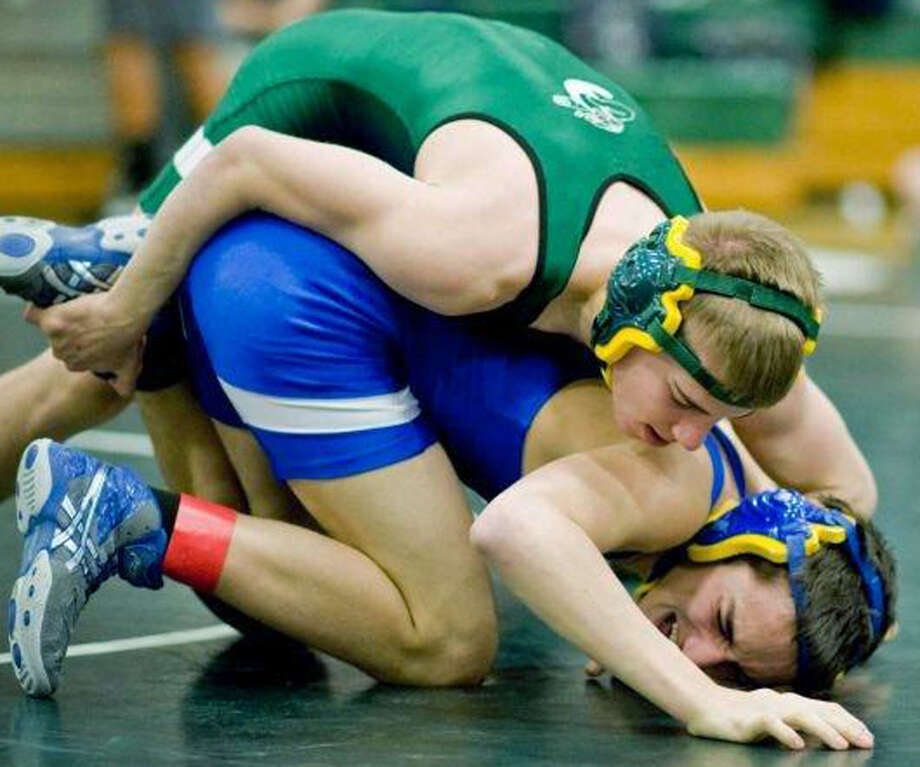 Zach Arnold of the Green Wave displays his mat skills en route to a runnerup performance at 132 pounds during New Milford High School wrestling's annual invitational tournament, Jan. 19, 2013 at NMHS  Photo by Scott Mullin Photo: Contributed Photo
