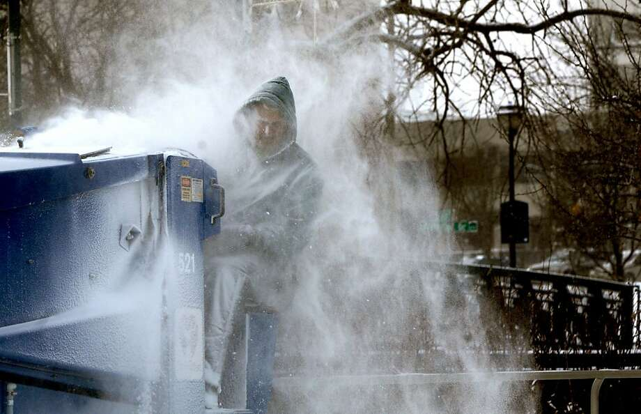 Elkhart, Ind. Buildings and Grounds employee Kevin Miller is covered in snow as he drives the Zamboni over the ice at the Nibco Ice and Water Park on Tuesday, Jan. 22, 2013. The extremely cold temperatures make working outside an even bigger challenge than normal.  (AP Photo/The Elkhart Truth, Jennifer Shephard) Photo: Jennifer Shephard, Associated Press