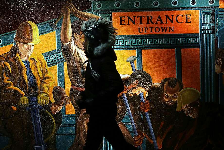 NEW YORK, NY - JANUARY 22: A man walks by a mural in a Times Square subway station near where a person jumped in front of a train on January 22, 2013 in New York City. New York City has been experiencing a rash of high-profile incidents involving individuals being hit by trains in suicides, accidents and people being pushed to their deaths.  (Photo by Spencer Platt/Getty Images) Photo: Spencer Platt, Getty Images