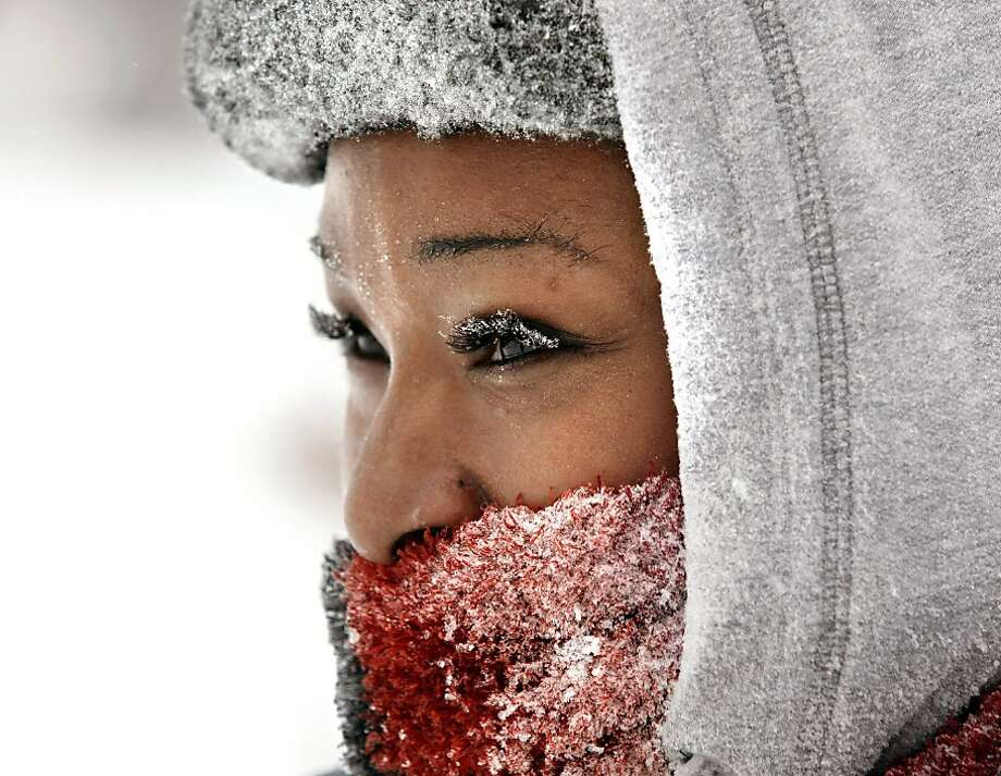 Ice crystals cling to Barbara Johnson's eyelashes as she spends a snow day sledding with family at Maple Street Magnet School Tuesday, Jan. 22, 2013, in Kalamazoo, Mich. (AP Photo/The Kalamazoo Gazette, Mark Bugnaski) Photo: Mark Bugnaski, Associated Press