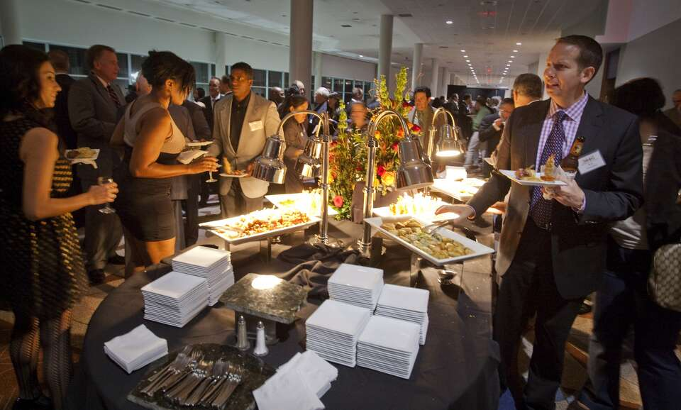 Houston Chronicle employees and guests mingle.