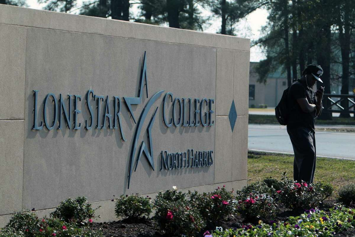Lone Star College student Kendrick Ferguson waits for his ride at one of the schools entrances after a shooting which left several people injured Tuesday, Jan. 22, 2013, in Houston.
