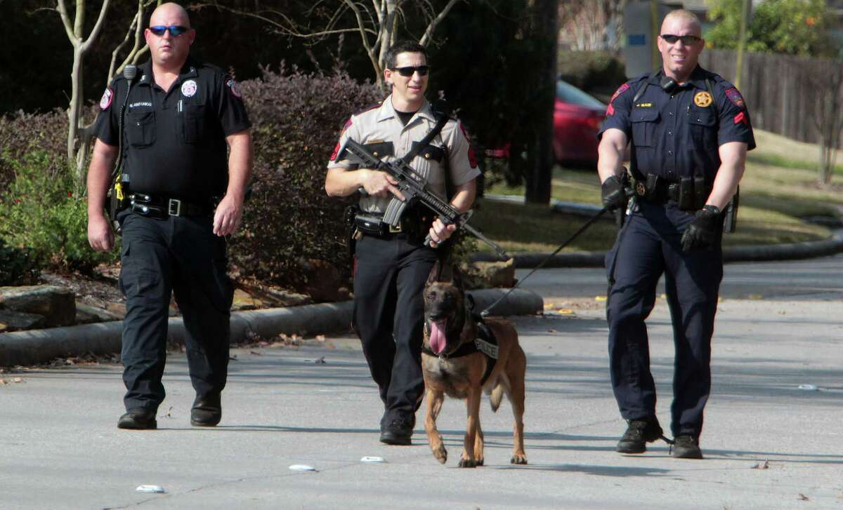 Law enforcement officers search for a gunman after a shooting at Lone Star College Tuesday, Jan. 22, 2013, in Houston.