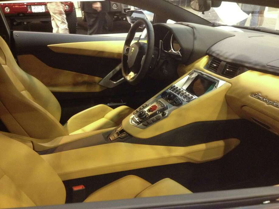 The Lamborghini Aventador sits on the Houston Auto Show floor. Photo: Dan X. McGraw