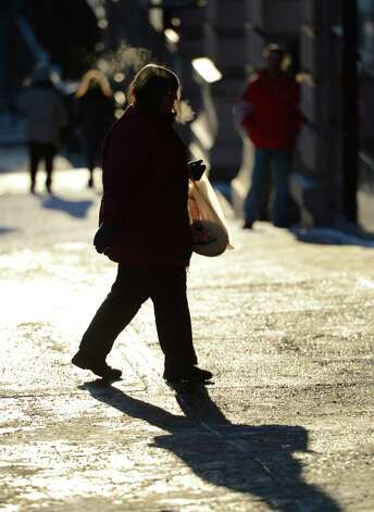 Single-digit temperatures have the commuters bundled up Wednesday morning, Jan. 23, 2013, in downtown Albany, N.Y. (Skip Dickstein/Times Union) Photo: SKIP DICKSTEIN