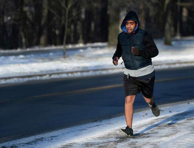 University at Albany student Roger Osorio didn't let single-digit temperatures deter him from a jog around the uptown campus Wednesday morning, Jan. 23, 2013, Albany, N.Y. (Skip Dickstein/Times Union) Photo: SKIP DICKSTEIN