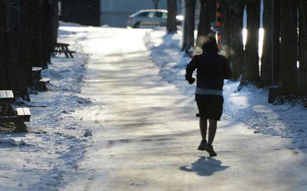 UAlbany student Roger Osorio didn't let single-digit temperatures deter him from a jog around the uptown campus Wednesday morning, Jan. 23, 2013, Albany, N.Y. (Skip Dickstein/Times Union) Photo: SKIP DICKSTEIN