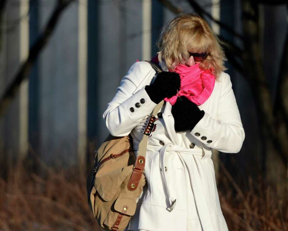 Reisha Rieder bundles up from the cold as she comes to work on the uptown University at Albany campus Wednesday morning, Jan. 23, 2013, Albany, N.Y. (Skip Dickstein/Times Union) Photo: SKIP DICKSTEIN