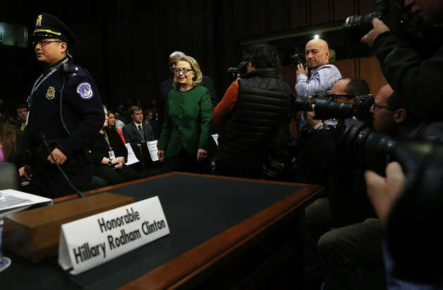 U.S. Secretary of State Hillary Clinton arrives at a hearing before the Senate Foreign Relations Committee about the September 11 attacks against the U.S. mission in Benghazi, Libya, on Capitol Hill January 23, 2013 in Washington, DC. Lawmakers questioned Clinton about the security failures that led to the death of four Americans, including U.S. Ambassador Christopher Stevens. Photo: Alex Wong, Getty Images / 2013 Getty Images