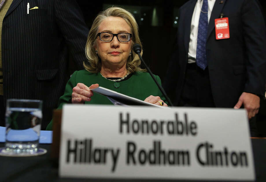 U.S. Secretary of State Hillary Clinton takes her seat prior to a hearing before the Senate Foreign Relations Committee about the September 11 attacks against the U.S. mission in Benghazi, Libya, on Capitol Hill January 23, 2013 in Washington, DC. Lawmakers questioned Clinton about the security failures that led to the death of four Americans, including U.S. Ambassador Christopher Stevens. Photo: Alex Wong, Getty Images / 2013 Getty Images