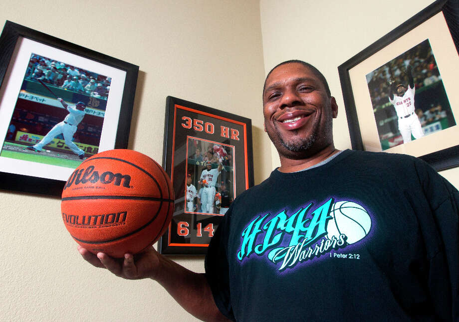 Rhodes poses for a photo in his Missouri City home. Photo: J. Patric Schneider, For The Chronicle / © 2013 Houston Chronicle