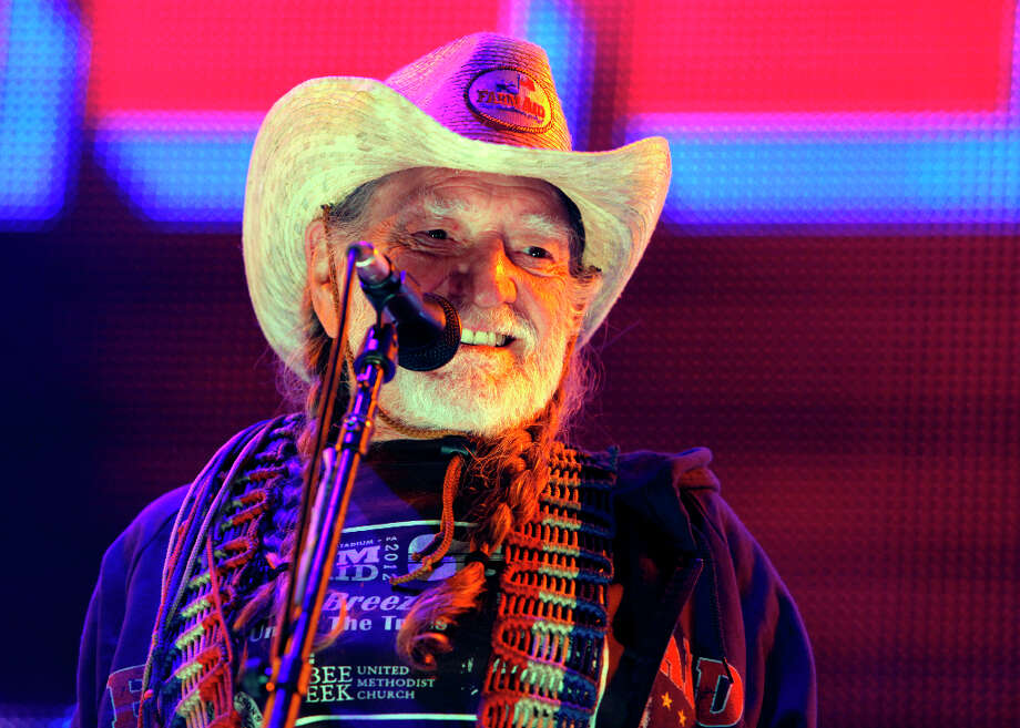 "FILE - This Sept. 22, 2012, file photo shows country music legend Willie Nelson performing during the Farm Aid 2012 concert at Hersheypark Stadium in Hershey, Pa. Nelson will release ""Roll Me Up And Smoke Me When I Die"" on Nov. 13. Publisher William Morrow says the American music icon will tell never-before-heard stories about his life, family, music, politics, Texas, religion and favorite recreational activity. Photo: Jacqueline Larma, AP / AP"