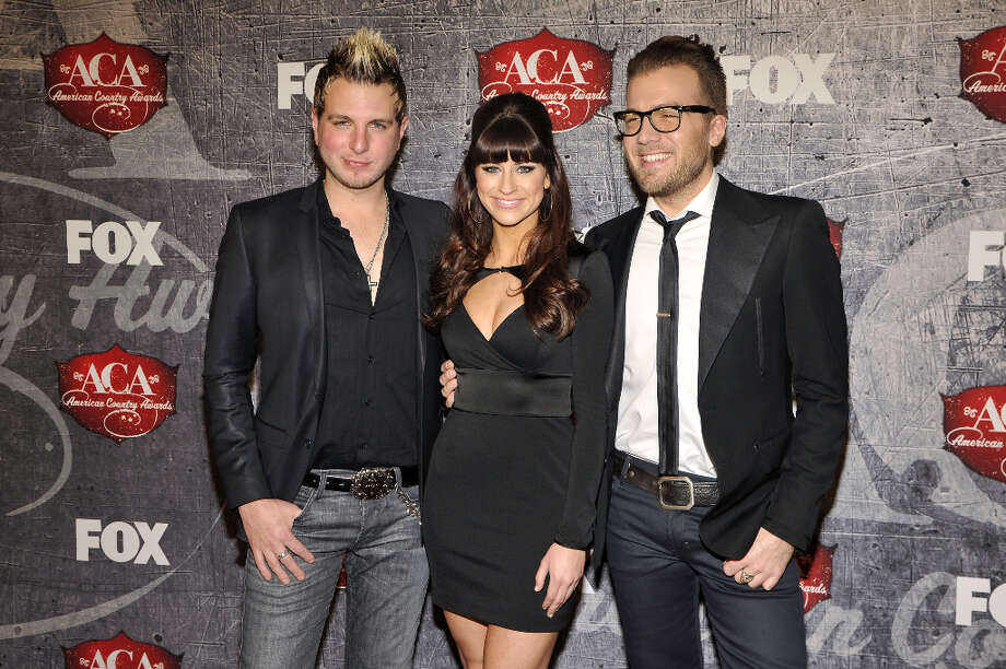 From left, Mike Gossin, Rachel Reinert and Tom Gossin of Gloriana arrive at the American Country Awards on Monday, Dec. 10, 2012, in Las Vegas. Photo: Jeff Bottari, Jeff Bottari/Invision/AP / Invision
