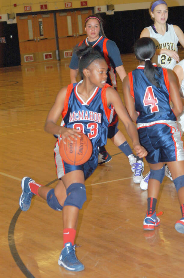 Jazmine Taylor dribbles the ball during a game against Trumbull Tuesday night. Photo: Andy Hutchison