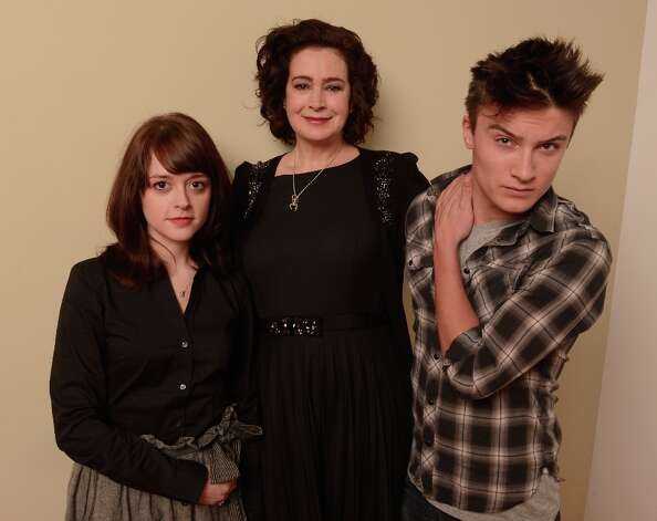 (L-R) Actors Lauren Ashley Carter, Sean Young and Daniel Manche from the film Jug Face pose for a portrait during the 2013 Sundance Film Festival at the Getty Images Portrait Studio at Village at the Lift on January 22, 2013 in Park City, Utah. Photo: Larry Busacca, Getty Images / 2013 Getty Images