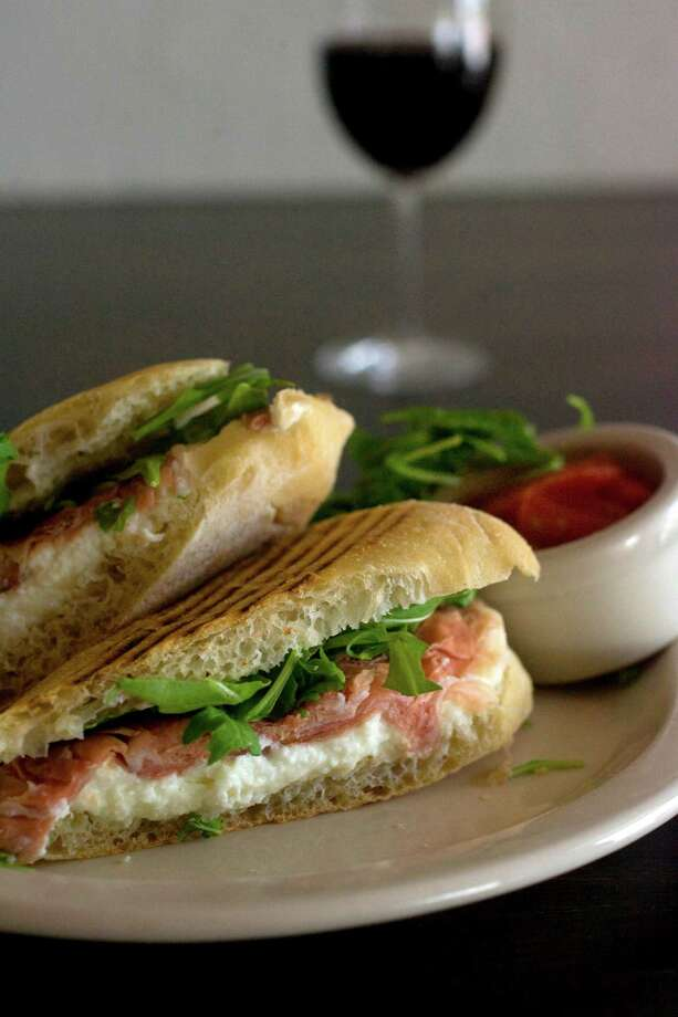 Panini with prosciutto, mozzarella and arugula at Vinoteca Poscol on the 1600 block of Westheimer Friday, Sept. 11, 2009, in Houston. ( Johnny Hanson / Chronicle ) Photo: Johnny Hanson, Staff / Houston Chronicle