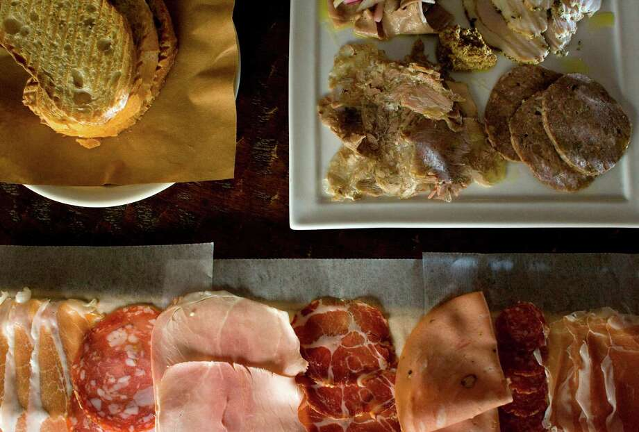 Salumi with house-made salumi testa, veal lingua, pork cheek sausage and porchetta as well as various other meats including prosciutto, spicy coppa and tuscan garlic salame at the Italian Vinoteca Poscol on 1609 Westheimer Rd. Photo: Johnny Hanson, Staff / Houston Chronicle