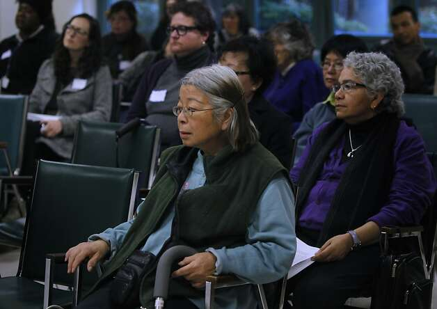 Jeannie Wong (center) listens to the results of a research study on suicide rates among senior Chinese Americans, before describing her own struggle with suicide in San Francisco, Calif. on Wednesday, Jan. 16, 2013. Photo: Paul Chinn, The Chronicle