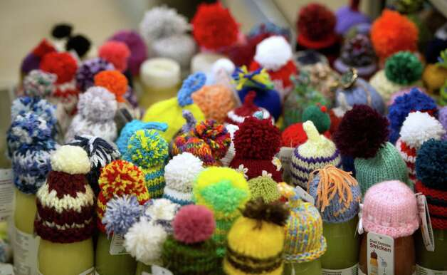 Little knitted caps are placed on top of Fruit smoothies during the 2013 World Economic Forum Annual Meeting on January 23, 2013, at the Swiss resort of Davos. The World Economic Forum (WEF)is taking place from January 23 to 27.  AFP PHOTO / JOHANNES EISELEJOHANNES EISELE/AFP/Getty Images Photo: JOHANNES EISELE, AFP/Getty Images / AFP