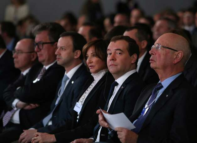 Dmitry Medvedev, Russia's prime minister, second right, listens during the opening session on the first day of the World Economic Forum (WEF) in Davos, Switzerland, on Wednesday, Jan. 23, 2013. World leaders, Influential executives, bankers and policy makers attend the 43rd annual meeting of the World Economic Forum in Davos, the five day event runs from Jan. 23-27. Photographer: Chris Ratcliffe/Bloomberg *** Local Caption *** Dmitry Medvedev Photo: Chris Ratcliffe, Bloomberg / Copyright 2013 Bloomberg Finance LP, All Rights Reserved.