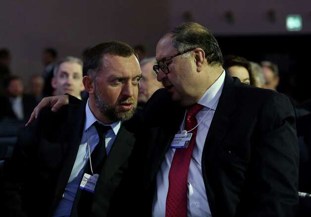 Oleg Deripaska, chief executive officer of United Co. Rusal, left, speaks with Russian billionaire Alisher Usmanov, before the opening keynote speech on the first day of the World Economic Forum (WEF) in Davos, Switzerland, on Wednesday, Jan. 23, 2013. World leaders, Influential executives, bankers and policy makers attend the 43rd annual meeting of the World Economic Forum in Davos, the five day event runs from Jan. 23-27. Photographer: Chris Ratcliffe/Bloomberg *** Local Caption *** Oleg Deripaska; Alisher Usmanov Photo: Chris Ratcliffe, Bloomberg / Copyright 2013 Bloomberg Finance LP, All Rights Reserved.