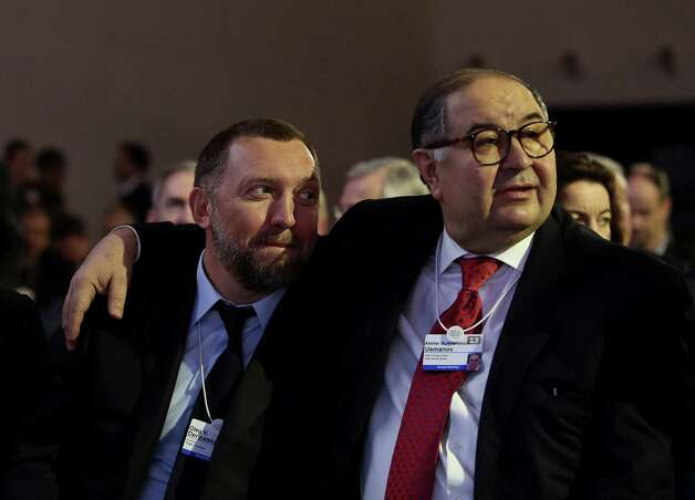 Oleg Deripaska, chief executive officer of United Co. Rusal, left, sits with Russian billionaire Alisher Usmanov, before the opening keynote speech on the first day of the World Economic Forum (WEF) in Davos, Switzerland, on Wednesday, Jan. 23, 2013. World leaders, Influential executives, bankers and policy makers attend the 43rd annual meeting of the World Economic Forum in Davos, the five day event runs from Jan. 23-27. Photographer: Chris Ratcliffe/Bloomberg *** Local Caption *** Oleg Deripaska; Alisher Usmanov Photo: Chris Ratcliffe, Bloomberg / Copyright 2013 Bloomberg Finance LP, All Rights Reserved.