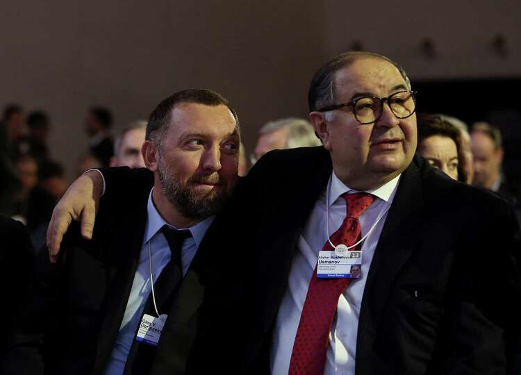 Oleg Deripaska, chief executive officer of United Co. Rusal, left, sits with Russian billionaire Ali