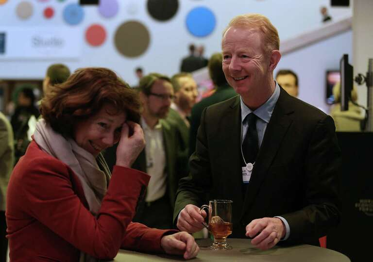 Marijn Dekkers, chief executive officer of Bayer AG, right, laughs with an attendee in the Congress